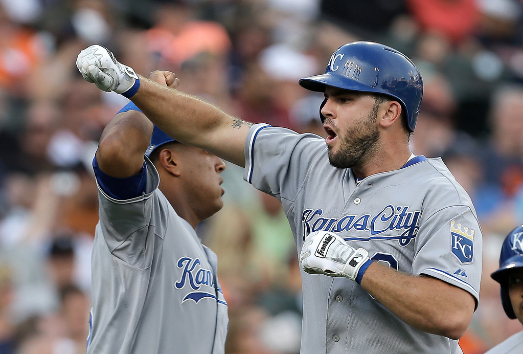 . Kansas City Royals\' Mike Moustakas, right, celebrates hitting a two-run home run against the Detroit Tigers with  Salvador Perez in the second inning of a baseball game in Detroit, Tuesday, June 17, 2014.  (AP Photo/Paul Sancya)