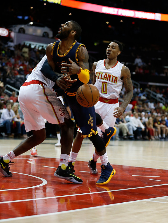 . Cleveland Cavaliers guard J.R. Smith (5) looses the ball against the Atlanta Hawks in the second half  of Game 4 of the second-round NBA basketball playoff series, Sunday, May 8, 2016, in Atlanta. (AP Photo/John Bazemore)