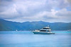 Large and luxurious fishing boat cruising through the tropics.