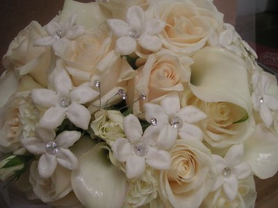 White stephanotis with pearls, ivory roses , spray roses, calla lilies- $155