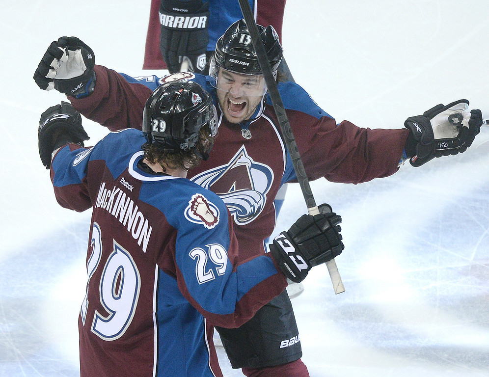 . DENVER, CO - APRIL 24: PA Parenteau embraced center Nathan MacKinnon after he scored in overtime to give the Avalanche a 4-3 win Saturday night. The Colorado Avalanche hosted the Minnesota Wild in the fifth game of a playoff series Saturday night, April 26, 2014. (Photo by Karl Gehring/The Denver Post)