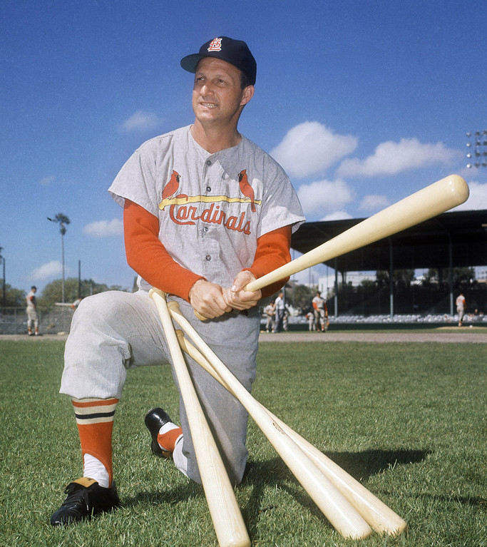 . FILE- In this March 23, 1964 file photo, Stan Musial visits his former teammates at the St. Louis Cardinals spring training baseball camp in Florida. Musial, one of baseball\'s greatest hitters and a Hall of Famer with the Cardinals for more than two decades, died Saturday, Jan. 19, 2013, the team announced. He was 92.  (AP Photo/File)