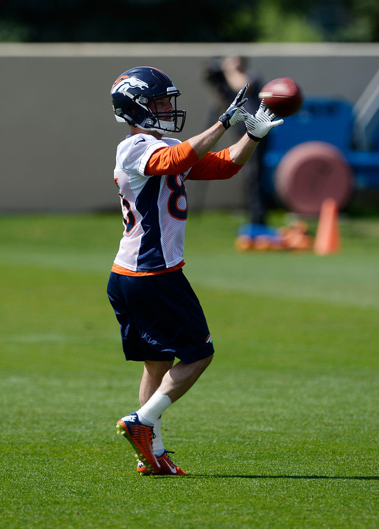 . Denver Broncos WR Wes Welker (83) catches a pass during drills during OTAs June 16, 2014 at Dove Valley. (Photo by John Leyba/The Denver Post)
