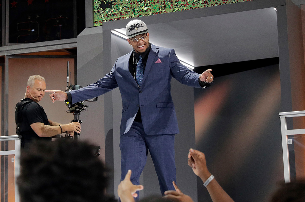 . CORRECTS THAT DAVENPORT PLAYED AT UTSA, INSTEAD OF UTEP -  UTSA\'s Marcus Davenport walks onto the stage after being selected by the New Orleans Saints during the first round of the NFL football draft, Thursday, April 26, 2018, in Arlington, Texas. (AP Photo/David J. Phillip)