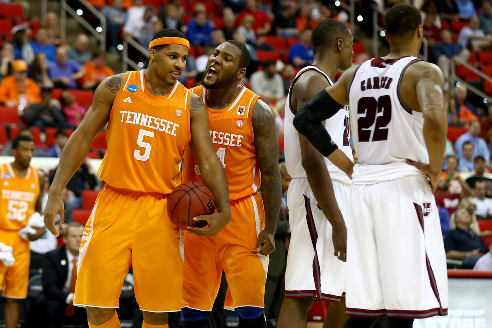 . Jarnell Stokes #5 and Jeronne Maymon #34 of the Tennessee Volunteers react in the second half while taking on the Massachusetts Minutemen in the second round of the 2014 NCAA Men\'s Basketball Tournament at PNC Arena on March 21, 2014 in Raleigh, North Carolina.  (Photo by Streeter Lecka/Getty Images)