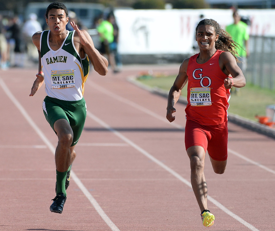 . Damien\'s Thaddeus Smith, left, competes in the 200 meter Dash Invitational during the Mt. SAC Relays in Hilmer Lodge Stadium on the campus of Mt. San Antonio College in Walnut, Calif., on Saturday, April 19, 2014. 