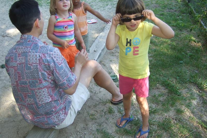 Guen tries David's shades.