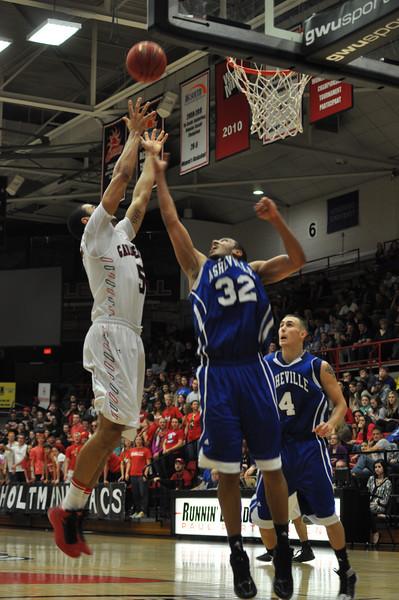 GWU Onzie Branch rebounds a shot against UNC Asheville