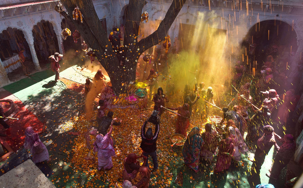 . Indian widows celebrate Holi with water and gulal (colored powder) in Vrindavan on March 14, 2014.   AFP PHOTO/Prakash SINGH/AFP/Getty Images