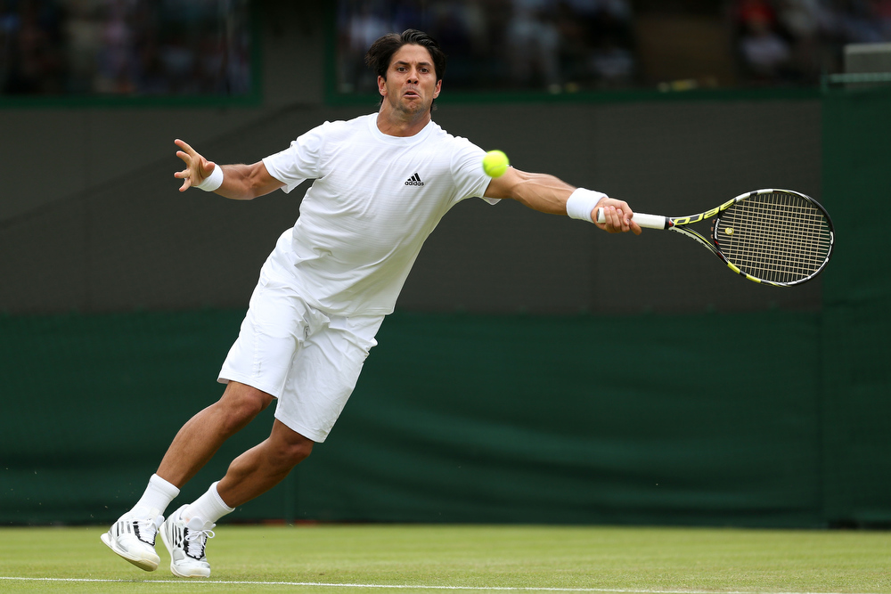 . Fernando Verdasco of Spain plays a forehand during his Gentlemen\'s Singles second round match against Julien Benneteau of France on day three of the Wimbledon Lawn Tennis Championships at the All England Lawn Tennis and Croquet Club on June 26, 2013 in London, England.  (Photo by Clive Brunskill/Getty Images)