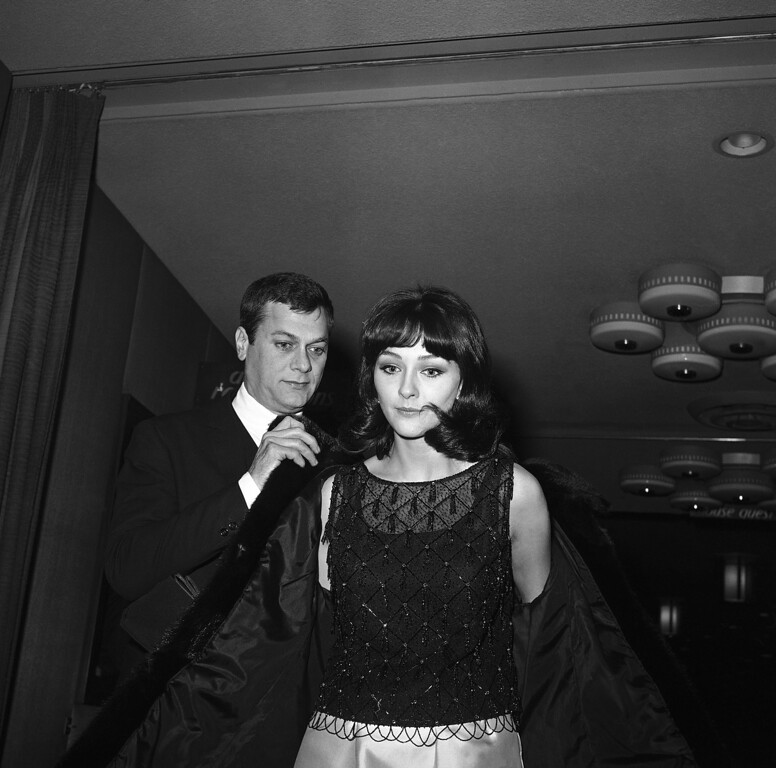 . Actor Tony Curtis, and German actress Christine Kaufmann, 18, arrive at Harrah?s Club in Stateline, Nev. for a premiere showing of his latest picture, ?Forty Pounds of Trouble,? Jan. 19, 1963.  Miss Kaufmann is not in the picture but accompanied Curtis here from Hollywood for a weekend near Lake Tahoe. Friends of the couple predict an early wedding for the two. (AP Photo)