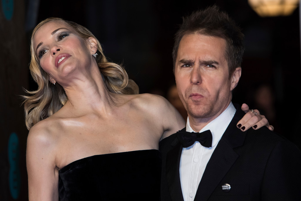 . Sam Rockwell and partner Leslie Bibb pose for photographers upon arrival at the BAFTA Awards 2018 in London, Sunday, Feb. 18, 2018. (Photo by Vianney Le Caer/Invision/AP)