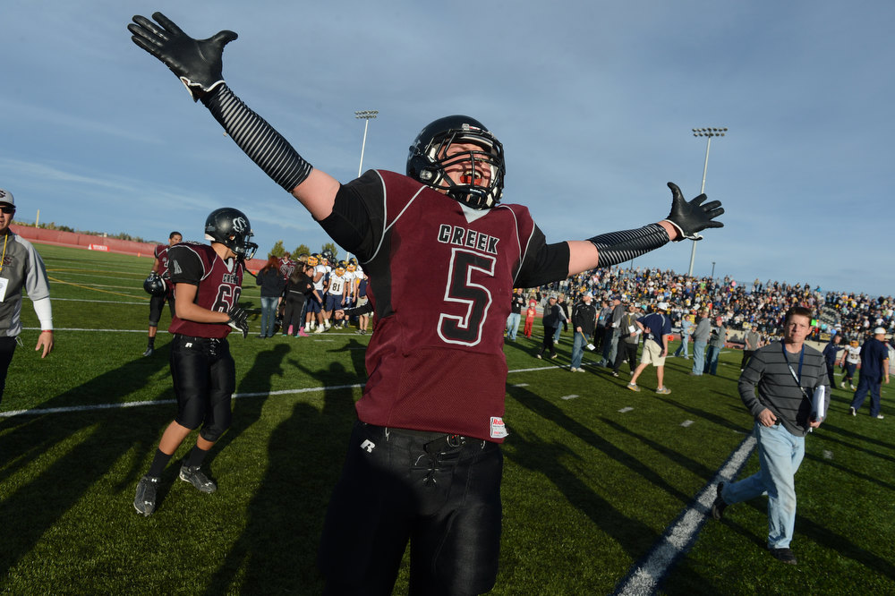 . Silver Creeks Andre Apodaca celebrates after winning the Class 3A Championship football game, Saturday December 01, 2012.  The Silver Creek Raptors beat  the Rifle Bears 32 - 15 at Legacy Stadium in Aurora, CO. Craig F. Walker, The Denver Post