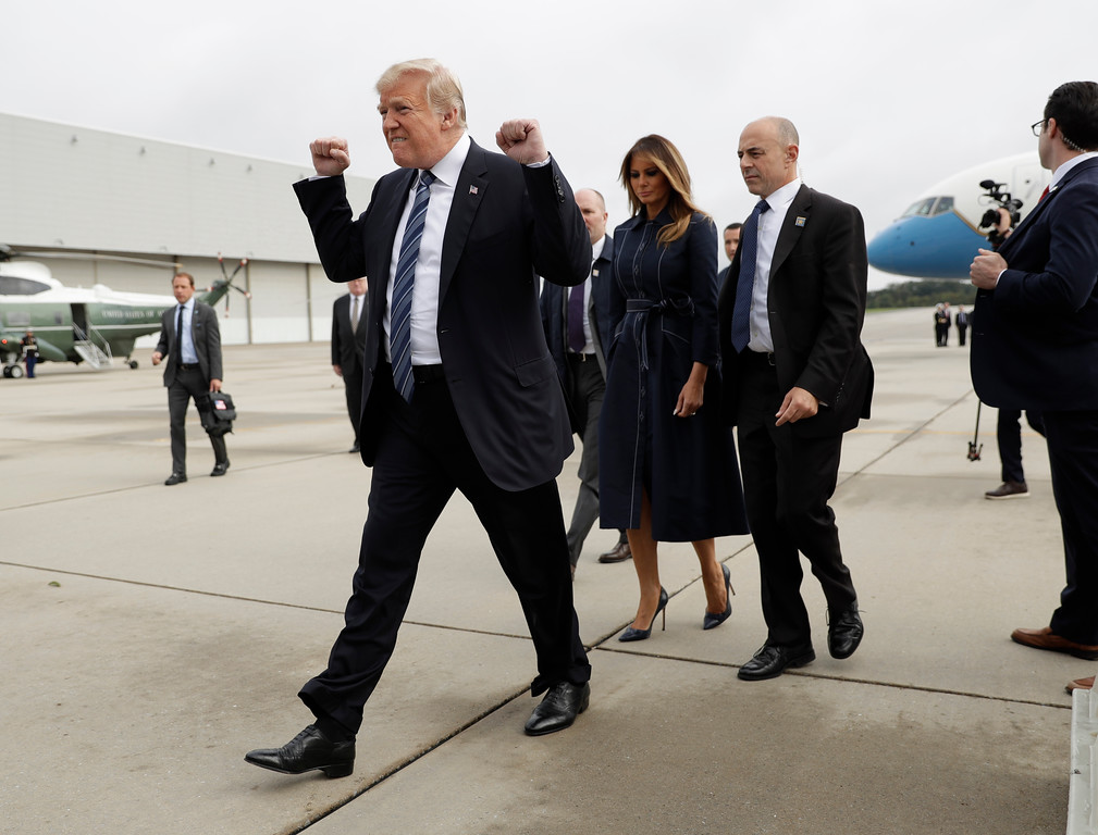 . President Donald Trump and first lady Melania Trump arrive at John Murtha Johnstown-Cambria County Airport in Johnstown, Pa., Tuesday, Sept. 11, 2018. Trump will be speaking during the September 11th Flight 93 Memorial Service in Shanksville, Pa. (AP Photo/Evan Vucci)