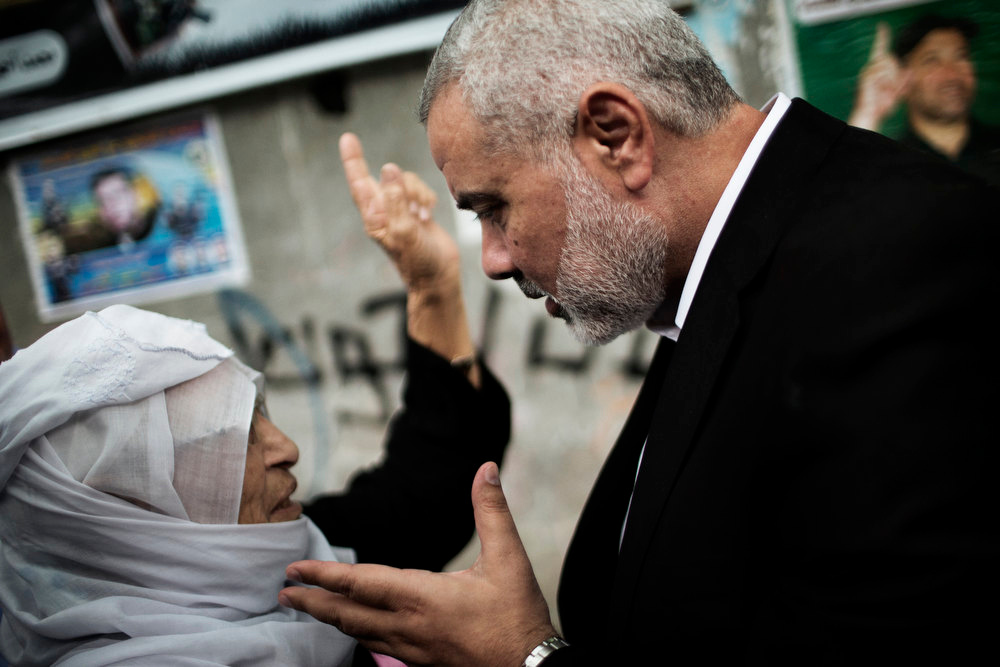 Description of . Palestinian Hamas leader in the Gaza Strip Ismail Haniya (R) consoles the mother of Ahmed Jaabari, the late leader of the Hamas armed wing, the Ezzedine al-Qassam Brigades, in Gaza City on November 22, 2012. Jaabari was killed when his car was hit by an Israeli airstrike in Gaza City on November 14.  MARCO LONGARI/AFP/Getty Images
