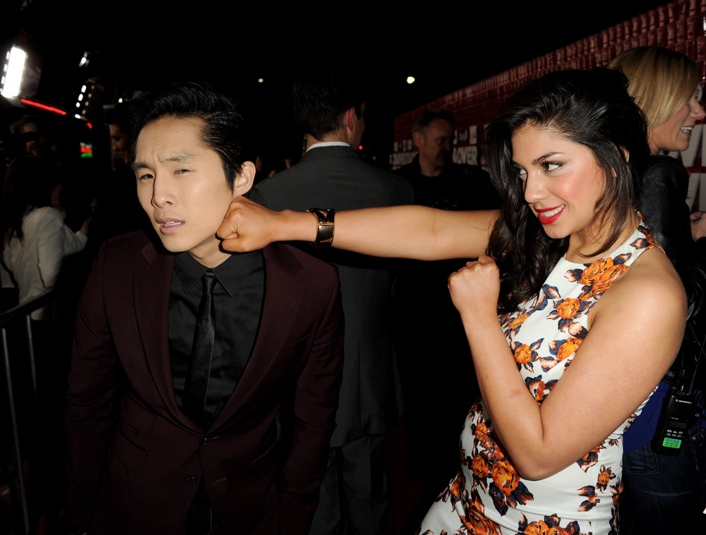 """. Actors Justin Chon (L) and Raquael Torres arrive at the premiere of Relativity Media\'s \""""21 And Over\"""" at the Village Theatre on February 21, 2013 in Los Angeles, California.  (Photo by Kevin Winter/Getty Images)"""