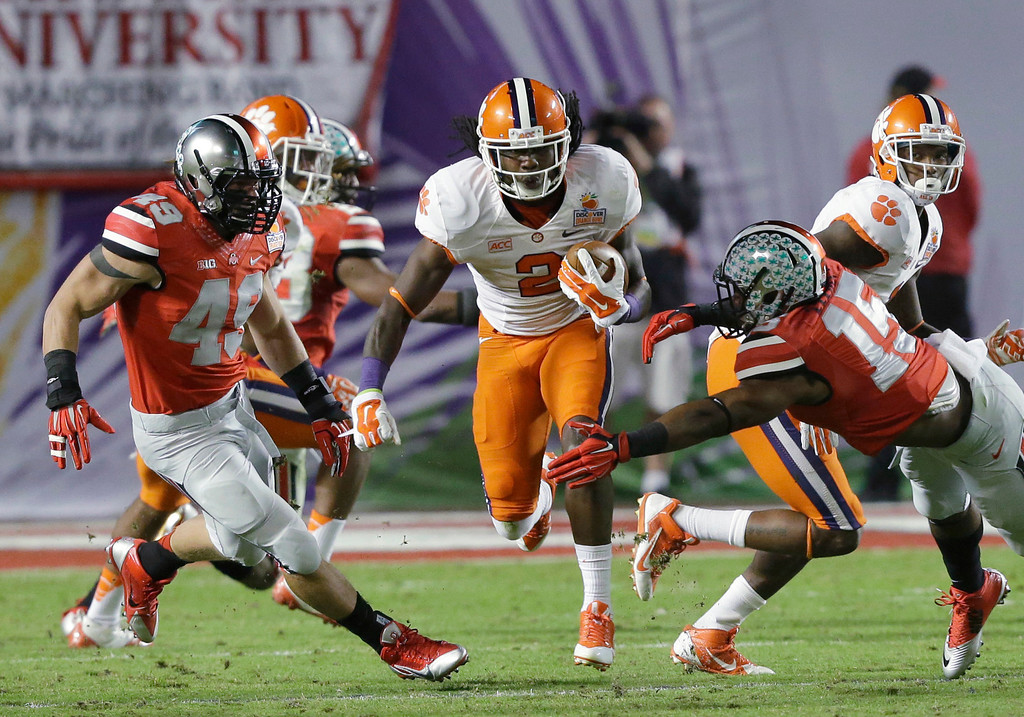 . Clemson wide receiver Sammy Watkins (2) runs between Ohio State defenders during the first half of the Orange Bowl NCAA college football game, Friday, Jan. 3, 2014, in Miami Gardens, Fla. (AP Photo/Wilfredo Lee)