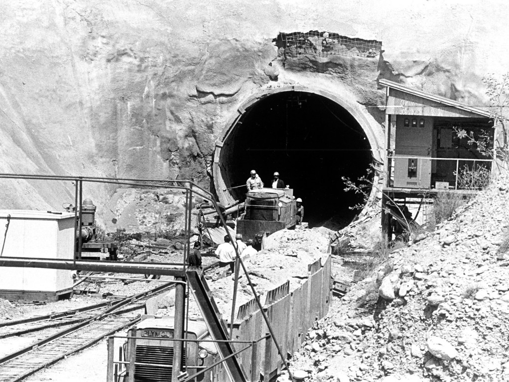 . Weary workmen emerge from Metropolitan District\'s San Fernando tunnel. Early morning explosion trapped workers about 250 feet below surface at Sylmar site.   Daily News file photo