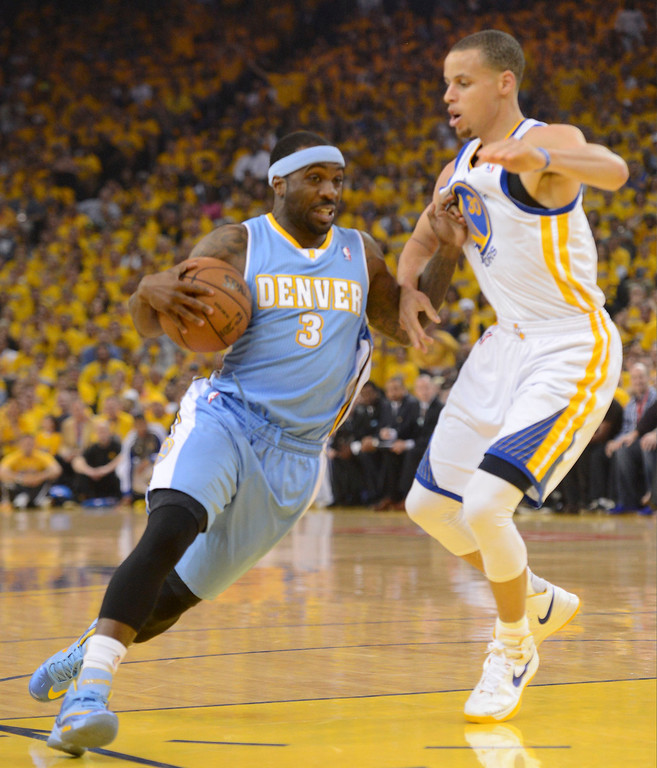 . Ty Lawson (3) of the Denver Nuggets drives on Stephen Curry (30) of the Golden State Warriors during the first quarter in Game 6 of the first round NBA Playoffs May 2, 2013 at Oracle Arena. (Photo By John Leyba/The Denver Post)