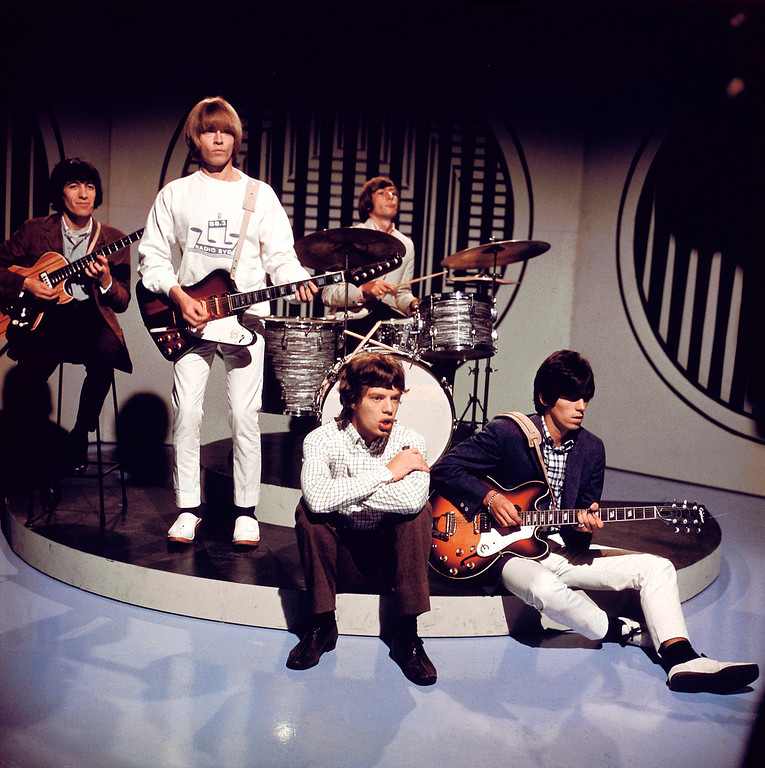 . The Rolling Stones, L-R: Bill Wyman, Brian Jones, Mick Jagger, Charlie Watts (behind), Keith Richards (playing Epiphone guitar), posed on set of TV Show  (Photo by David Redfern/Redferns)