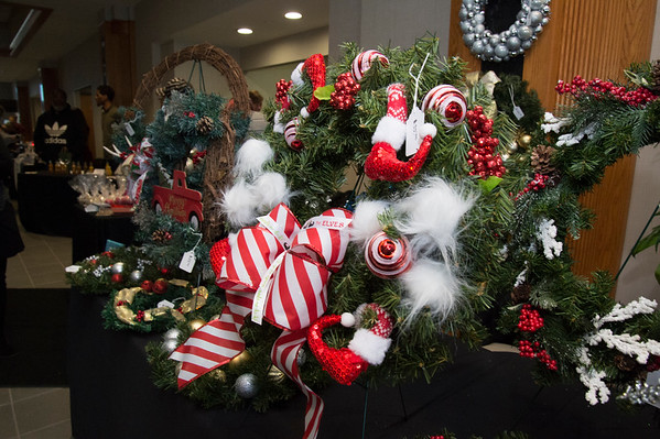 12/12/19 Wesley Bunnell | StaffrrBella Creations Home Staging and Redesign had a table full of wreaths for sale during the Holiday Craft Fair at 1 Liberty Square on Thursday afternoon.