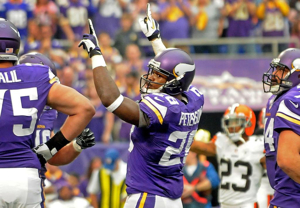 . Vikings running back Adrian Peterson celebrates his 2-yard touchdown run alongside teammate Matt Kalil, left, during the first quarter. (Pioneer Press: Sherri LaRose-Chiglo)