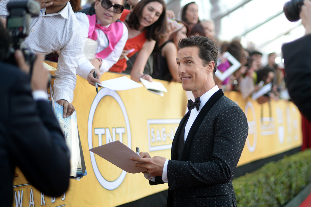 . Matthew McConaughey signs autographs on the red carpet at the 20th Annual Screen Actors Guild Awards  at the Shrine Auditorium in Los Angeles, California on Saturday January 18, 2014 (Photo by Hans Gutknecht / Los Angeles Daily News)