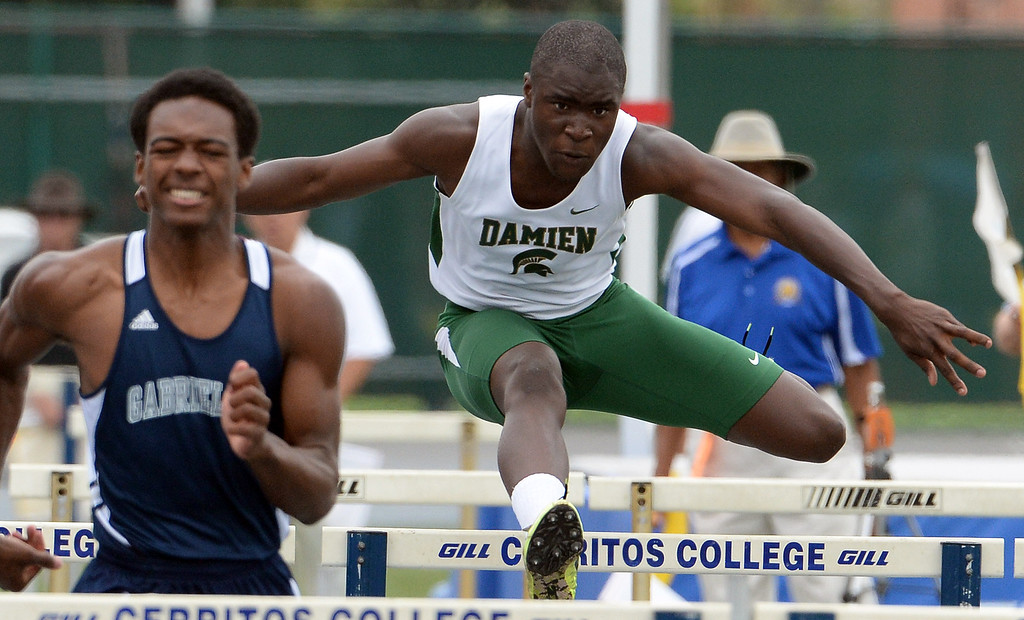 . Damien\'s Kaodilichi Nwuda competes in the division 3 110 meter high hurdles during the CIF Southern Section track and final Championships at Cerritos College in Norwalk, Calif., Saturday, May 24, 2014.   (Keith Birmingham/Pasadena Star-News)