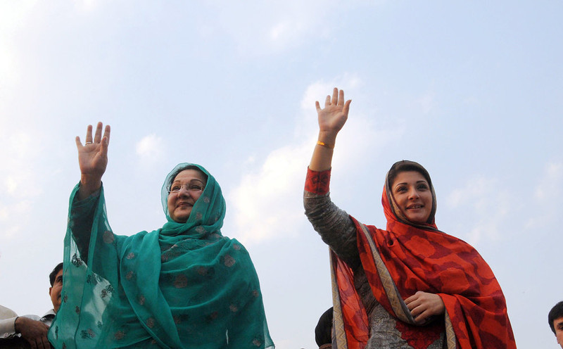 . Maryam Nawaz (R), daughter and Kulsoom Nawaz (L) wife of former Pakistan\'s premier Nawaz Sharif wave to supporters as they take part of election campaign in Lahore on May 4, 2013. A Pakistani candidate running for parliament in next week\'s historic election was injured on Saturday as his vehicle hit a roadside bomb in the troubled northwest, officials said.   AFP/Getty Images
