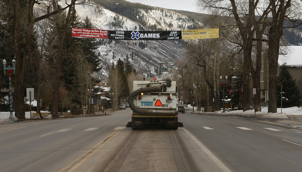 . ASPEN, CO. - JANUARY 24:  The 2013. Winter X Games officially kicked off in Aspen. A street sweeper cleans Main Street in downtown Aspen, January 24, 2013,as visitors start to arrive in town. (Photo By RJ Sangosti / The Denver Post)