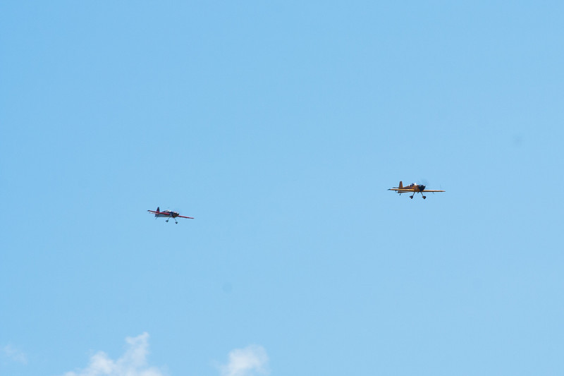 1/3 scale RC plane flys in formation with Matt Chapman.