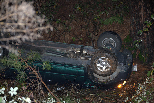 12292010 Truck looses control on black ice and overturns into flooded gully