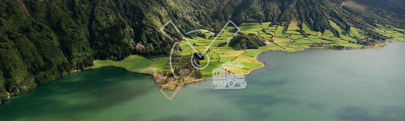 aerial landscape of the impressive volcanic crater with Lagoa Azul at Sete Cidades
