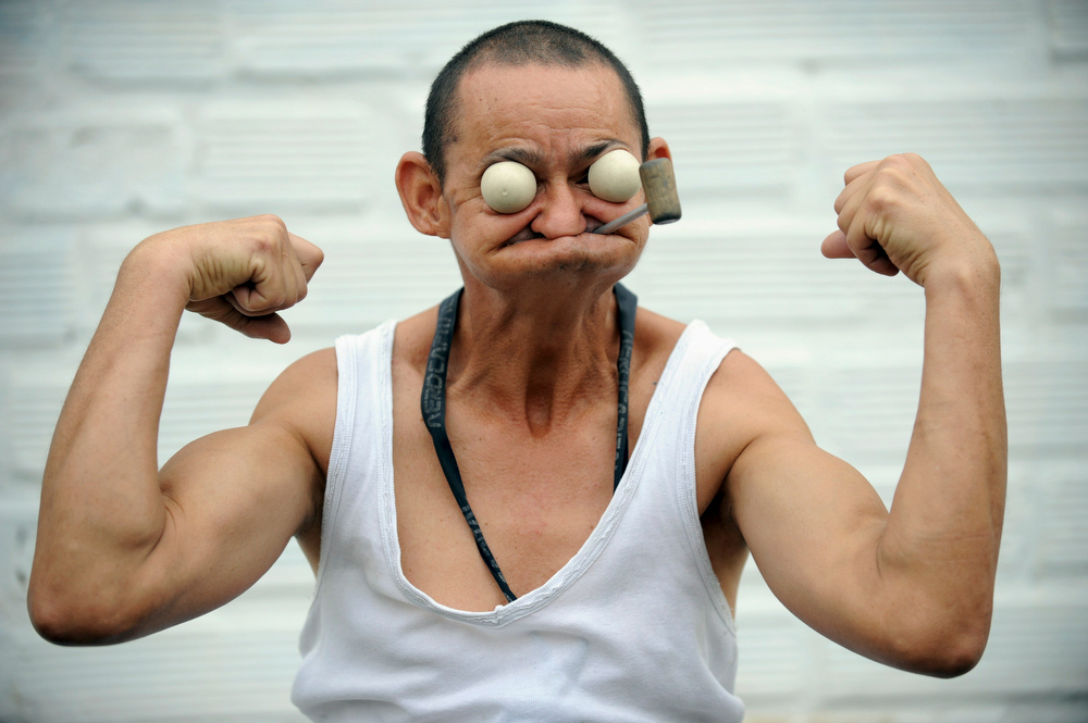Description of . Colombian William Chavarriaga, 49, performs as cartoon character Popeye the Sailor at Olaya Herrera airport on January 17 , 2011 in Medellin, Antioquia department, Colombia. Chavarriaga works since 30 years ago as employed to the airport in different trades.  AFP PHOTO / Raul ARBOLEDA