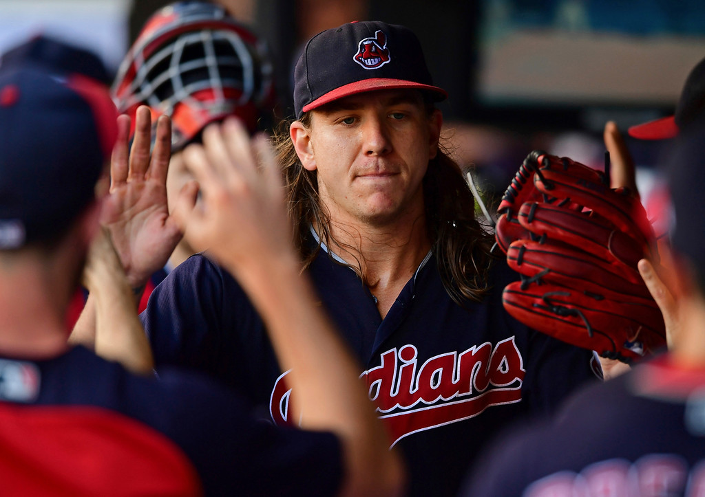 . Cleveland Indians starting pitcher Mike Clevinger is congratulated int he dugout in the fifth inning of a baseball game against the Detroit Tigers, Saturday, Sept.15, 2018, in Cleveland. (AP Photo/David Dermer)