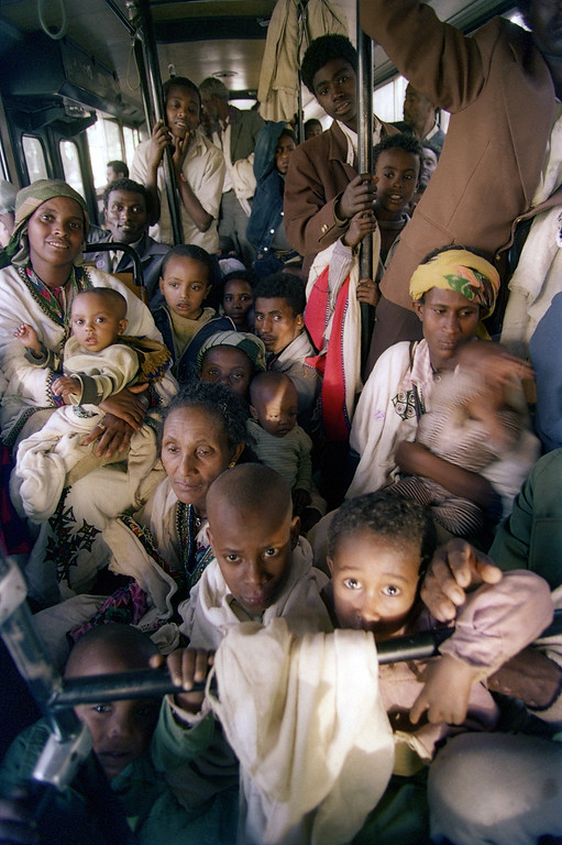 """. ADDIS ABEBA, ETHIOPIA:  Ethiopian Jews, known as \""""Falasha\"""", are bussed from the Israeli embassy to the Addis Ababa airport, 24 May 1991, as part of the world\'s largest airlift. Israel started airlifting some 18,000 Ethiopian Falasha Jews with the assistance of the United States as rebel pressure on the capital increases. JEROME DELAY/AFP/Getty Images"""