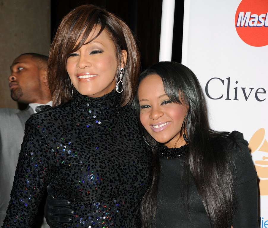. File - Singer Whitney Houston (L) and Bobbi Kristina Brown arrives at the 2011 Pre-GRAMMY Gala and Salute To Industry Icons Honoring David Geffen at Beverly Hilton on February 12, 2011 in Beverly Hills, California. Houston was born August 9, 1963 in Newark, New Jersey and died February 11, 2012, in Beverly Hills, California at the age of 48. Bobbi Kristina died on July 26, 2015. (Photo by Jason Merritt/Getty Images)