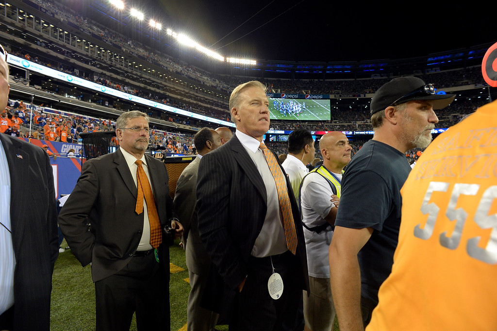 . Denver Broncos Executive V.P. of Football Operations John Elway looks on during the fourth quarter September 15, 2013 MetLife Stadium. (Photo by John Leyba/The Denver Post)