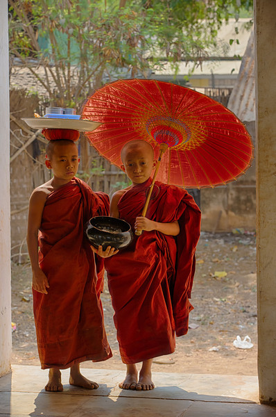 If you promise a donation young monks seem always ready to pose, but not always so happy about doing so.