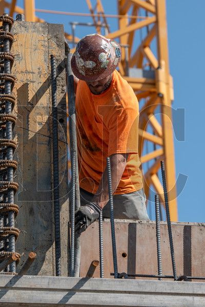 A Local 1503 and Lease Crutcher Lewis carpenter operates a vibrator as his crew pours building core walls at the Canvas project site. (Josh Kulla/DJC)