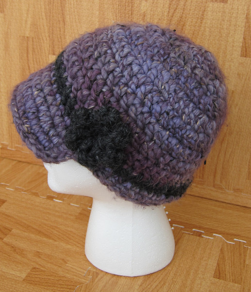 Riana Goes to Town Made from Gedifra Riana Big Color in Violet Haze and Lion Wool-Ease Thick and Quick in Charcoal Pattern Newsie Hat by Adrienne Engar