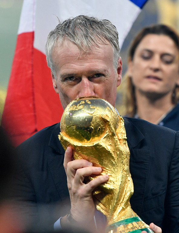. France head coach Didier Deschamps kisses the trophy after his team won the final match between France and Croatia at the 2018 soccer World Cup in the Luzhniki Stadium in Moscow, Russia, Sunday, July 15, 2018. (AP Photo/Martin Meissner)
