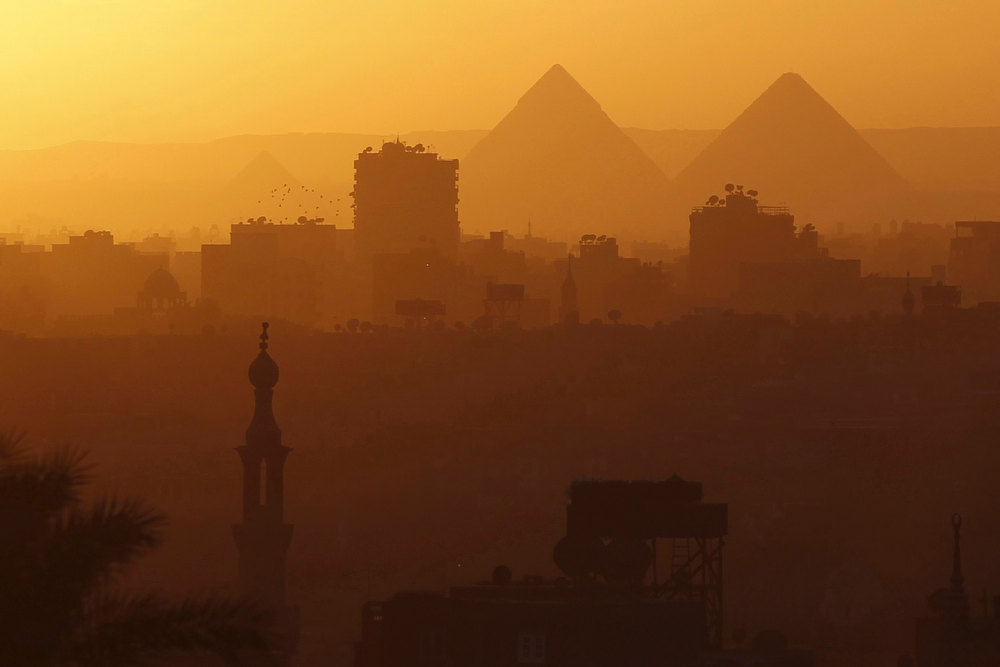 Description of . A general view of mosques and the great pyramids before sunset in Cairo, December 5, 2012. REUTERS/Amr Abdallah Dalsh