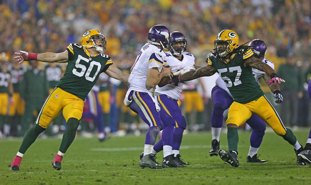 . GREEN BAY, WI - OCTOBER 02: A.J. Hawk #50 and  Jamari Lattimore #57 of the Green Bay Packers pressure Christian Ponder #7 of the Minnesota Vikings at Lambeau Field on October 2, 2014 in Green Bay, Wisconsin. (Photo by Jonathan Daniel/Getty Images)