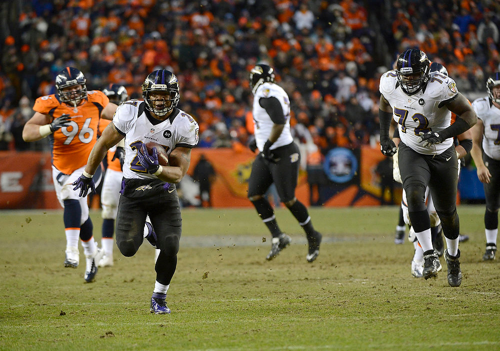 Description of . Baltimore Ravens running back Ray Rice (27) busts through the line and makes a run in the third quarter. The Denver Broncos vs Baltimore Ravens AFC Divisional playoff game at Sports Authority Field Saturday January 12, 2013. (Photo by Joe Amon,/The Denver Post)