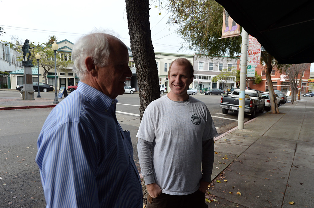 . Richmond city council member Tom Butt chats with son Daniel Butt, of Berkeley, in the Point Richmond area of Richmond, Calif. on Thursday, Jan. 24, 2013. (Kristopher Skinner/Staff)