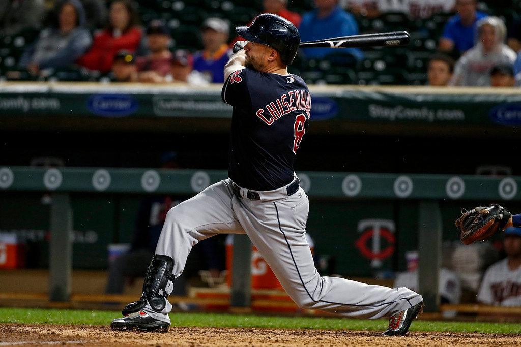 . Cleveland Indians\' Lonnie Chisenhall watches a three-run home run against the Minnesota Twins during the sixth inning of the second baseball game of a doubleheader Saturday, June 17, 2017, in Minneapolis. The Indians won 6-2. (AP Photo/Bruce Kluckhohn)