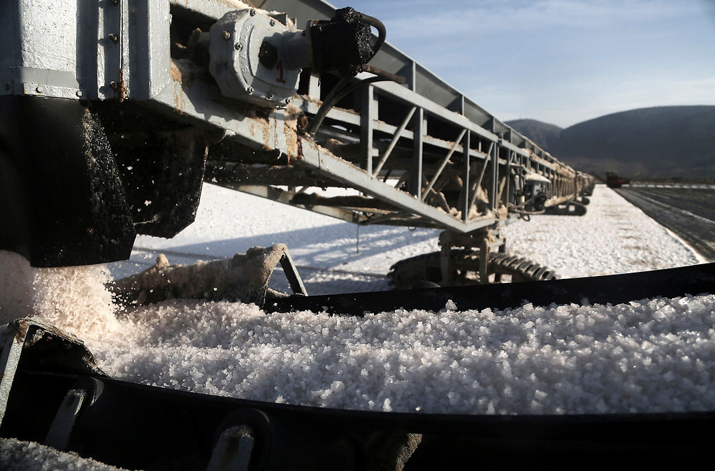 . Salt is collected at a production site in Messolongi, western Greece. Salt lakes at Messolongi are used for production by solar evaporation. The facilities are the largest saltworks in Greece, and are located at a protected wetland complex of estuaries and lagoons. (AP Photo/Dimitri Messinis)