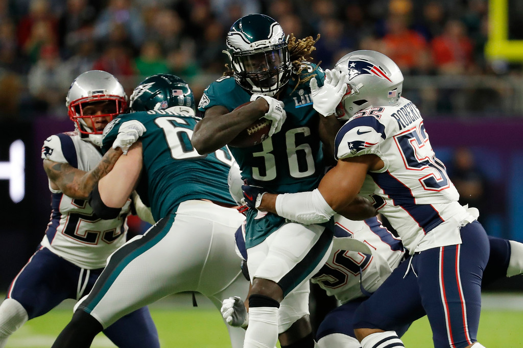 . Philadelphia Eagles running back Jay Ajayi (36), runs against New England Patriots outside linebacker Elandon Roberts (52), during the first half of the NFL Super Bowl 52 football game, Sunday, Feb. 4, 2018, in Minneapolis. (AP Photo/Charlie Neibergall)