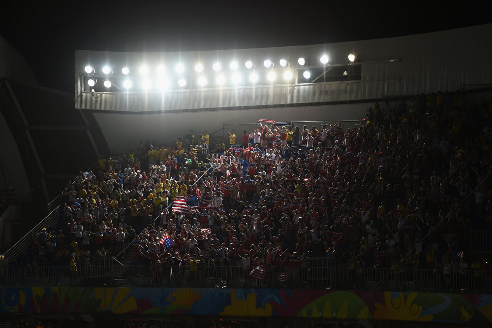 Description of . Fans of The United States  cheer during the 2014 FIFA World Cup Brazil Group G match between Ghana and the United States at Estadio das Dunas on June 16, 2014 in Natal, Brazil.  (Photo by Laurence Griffiths/Getty Images)